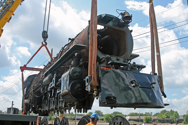 Milwaukee Road 261 is lifted by Vic's Crane & Heavy Haul of Rosemount, Minn., to remove its driving wheels for truing and other work.