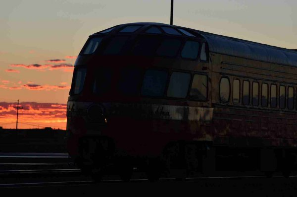 d37343-red-clouds-behind-cedar-rapids-on-sts-train-winslow-az-9-20-13